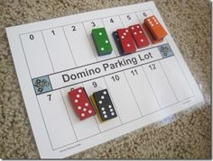 Set all the dominoes out, face down.  Draw one at a time.  If the sum matches an empty spot on your parking lot, you can play it there.  If not, turn it back over and let the next player choose.  First to cover their board wins.