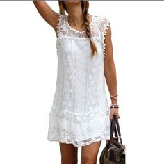 """Cute Lace Dress With Pom Pom Trim This dress is NWOT. Never worn. It is lined but still pretty sheer. Tag says XXL but runs small I would say it would fit a L best. It measures 20"""" underarm to underarm and us 35"""" long. The lace us really pretty. Dresses Midi"""