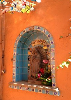 Virgin of Guadalupe. Tiled niche in a terra cotta wall in Mexico City #hacienda, #altar, #shrine