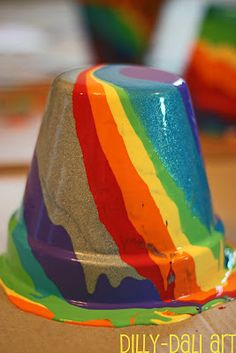 Rainbow Pour Painting {on terra cotta pots} - a St. Patrick's Day craft and also for spring.
