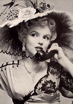 Marilyn Monroe on the phone in Edwardian garb.
