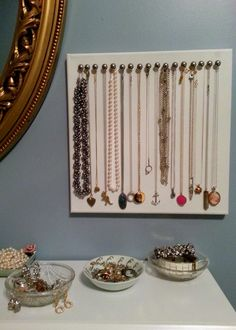 Canvas and furniture tacks to hold necklaces
