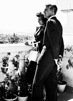 Cary Grant and Sophia Loren overlooking Madrid from a hotel balcony while shooting The Pride and the Passion, 1957.