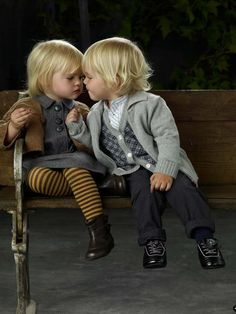 Little boy and girl on a bench
