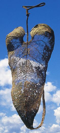 Embraced by Nature  Anda Klancic  1998, viscose, flax, cotton fabric, polyester thread,polyester and metal filament, PVA fabric. 70 x 27 x 24cm
