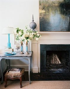 Through the Looking Glass  The dreamy Impressionist painting that hangs above this mantel looks like a window onto a serene country pond thanks to its large scale.