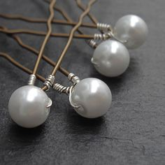 Pearl Hair Pins Custom Colours shown in White by WeddingAndGems. £12.99, via Etsy.