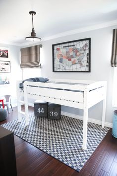 Modern and minimalist automotive-inspired boys room - love the loft bed and fun decor!