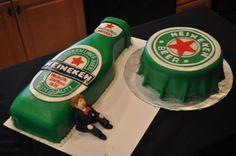 A cake decorated to be hubby's favorite beer! Genius! Heineken Man cake