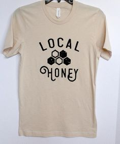 Our Local Honey tee is the perfect pun, screen printed on a super soft Bella+Canvas unisex tee in Soft Cream. This tee tends to run large so when in doubt, size down!  *In stock sizes are ready to ship. All other sizes are available for preorder. **Pre-Orders have a 30 day processing time.