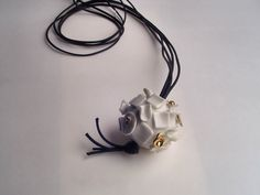 planet: necklace,                                                   hand shaped  translucent porcelain, fired to 1200°c, golden luster (3 fire 730°c), leather cord 50cm