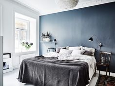 Bedroom with a blue wall
