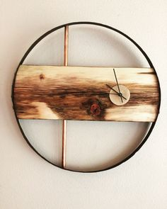 A personal favorite from my Etsy shop https://www.etsy.com/listing/479339972/rustic-modern-reclaimed-materials-clock