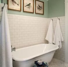 source: Rustic Rooster Interiors Beautiful bathroom with partially tiled white subway tile wall and marble hexagonal floor tile. A white claw foot tub stands in the tiled nook beside a blue and white garden stool. Bathroom Floor Tiles, Bathroom Renos, Tile Floor, Bathroom Green, Bathroom Ideas, Bathroom Wall, Marble Floor, Bathroom Marble, Room Tiles