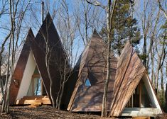 Designed by Hiroshi Nakamura & NAP, Nasu Tepee is a tipi-shaped house with a dark exterior that blends into the towering trees. Timber Structure, Concrete Structure, Cabins In The Woods, House In The Woods, Japanese Architecture, Modern Architecture, Japanese Landscape, Japanese Gardens, Architects Journal