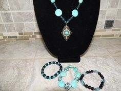 Beautiful turquoise and silver beaded necklace with 3 matching stretch bracelets.  Great Mothers day gift. by GabiLuBoutique on Etsy
