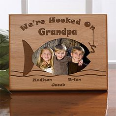 """""""We're Hooked On Grandpa"""" Personalized wood frame - Doesn't have to say """"Grandpa"""" it can say """"Dad,"""" """"Papa"""" or whatever you want. This is ADORABLE! What a great Father's Day Gift idea! Then all the kids' names are engraved at the bottom by the fish!"""