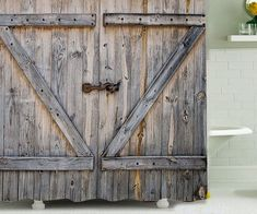 Country boys, take the barn door with you and curtain it right across your shower rod when you leave the family farm for the big city this fall. This door might have a little more polyester it in that your typical pine or cedar build--like 100% mo
