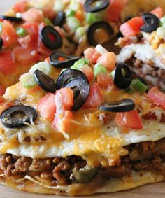 Recipe for Mexican Pizza - A tasty and easy Mexican-style pizza - delicious corn tortillas topped with beans, beef and all the delicious taco toppings you can imagine!