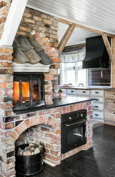 country kitchen, fireplace, shingles, exposed brick Think of the pizza!
