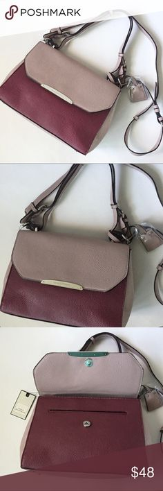 """NWT. Burgundy crossbody tote NWT. Burgundy crossbody tote. Adjustable and detachable long crossbody. Has a handle as well. Magnetic closure. Inside zipper and pocket. Sorry, no trades. Size: 11""""x8""""x4"""". Like the item but not the price, feel free to make me a reasonable offer using the offer button. Dana Buchman Bags Crossbody Bags"""