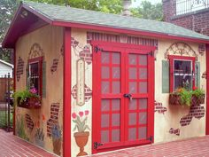 """Fountains and Waterfalls :   they painted this garden shed, it was white with burgundy trim. She gave it faux exposed """"brick"""" and flower pots to complement a brick Mediterranean-style home."""