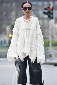 cd1789afd An oversized white sweater paired with leather trouser gives your outfit a  whole laid back vibe