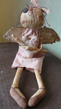this grungy angel doll is adorably UGLY!...(ummm....cute in an ugly way? or ugly in a cute way? whatever it may be, I LOVE her! hahaha!)
