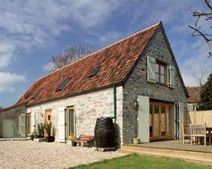 A Converted stone barn in Somerset uses conservation roof windows for a traditional window finish, via Homebuilding & Renovating.