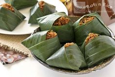 Pulut Inti is a traditional Malaysian dessert of steamed glutinous rice with a sweet coconut topping. They are usually wrapped in banana leaves.
