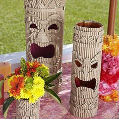 Art Luau decor DIY luau-birthday-party. Corrugated cardboard, layers to make tiki faces.  This is cool.