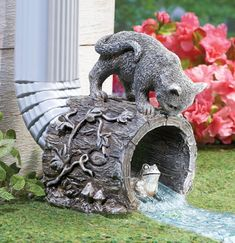 Attach this delightful sculpture to your downspout to direct water away from your foundation. The charming, hand-painted downspout looks like a hollow tree stump covered in flowers and colorful birds. Outdoor Garden Statues, Outdoor Garden Decor, Outdoor Cats, Decorative Downspouts, Gutter Garden, Collections Etc, Vegetable Garden Design, Lawn And Garden, Garden Frogs
