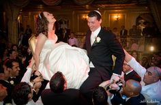 Couple are often held up on chairs by friends and people sing to them and honor their union.