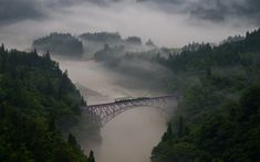 The first train goes across the railway bridge in the morning mist, Mishima town in Fukushima prefecture, Japan (photo by Teruo Araya for National Geographic Traveler Photo Contest) Photographie National Geographic, National Geographic Photography, Trains, National Geographic Photo Contest, Photo Voyage, Nature Sauvage, Voyager Loin, Train Pictures, Santa Fe