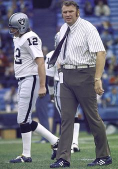 John Madden and Kenny Stabler-the engineers of a dominant Oakland Raiders team of the 1970s, the duo won Super Bowl 11 against the Vikings, 32-14.