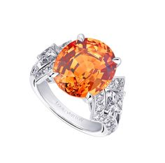 The Acte V collection Louis Vuitton Genesis ring with a juicy mandarin garnet surrounded by diamonds.