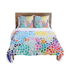 How fun! Duvet cover with a pixel-inspired motif by artist Garima Dhawan for DENY Designs.
