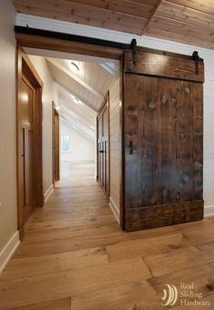 Barn doors made from reclaimed Douglas fir salvaged from a nearby warehouse. Love the dark wood on the doors with the light floor and white baseboards. Barn House, Doors Interior, House Design, New Homes, Barn Door, Remodel, House, Barn Door Hardware, Doors