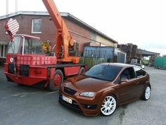 Brown Ford Focus ST 2 tuning with big white rims