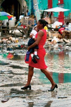 "By Mickelder Kercy.  ""This picture of a Haitian lady holding securely this child says it all. No matter how much catastrophes or other situations try to sabotage our lives, we must keep moving with resilience holding on to whatever best we have left, be it our family member, our friends, our physical and mental health and our hope and dreams."""