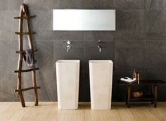 cutting edge bathroom-- love the rustic towel rack