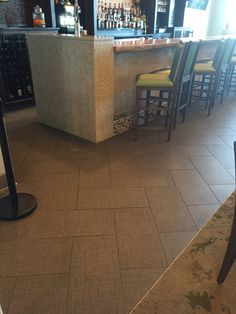 Daltile Exhibition EX11 Borrel 12x24.  Installed in herringbone pattern.