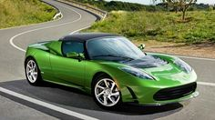 Tesla Roadster- would prefer in red or black though. Green is an ugly color for a car.