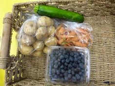 veggie box - Aug 14, 2012  blueberries, zucchini, baby carrots, and potatoes