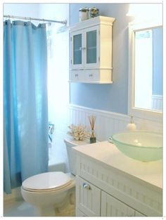 Beach Bathroom Theme.  I like how the sink looks a little like seaglass
