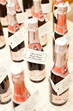 Mini bottles. Love this idea for wedding favors, escort cards or even place cards.