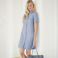 This stylish utility shirt dress is perfect for giving your Spring wardrobe a modern update. Made from pure linen, this collared short-sleeve style has buttons through the front and pockets on the chest. Wear this with flat sandals for understated dayt Jumpsuit Dress, Shirt Dress, The White Company, Sleeve Styles, Blue Dresses, Dress Outfits, Pure Products, Stylish, Casual