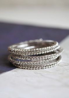 Fun accessories...don't have to be expensive but just sparkly and bright.