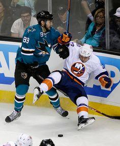 San Jose Sharks forward Barclay Goodrow knocks down Casey Cizikas of the New York Islanders (Nov. 1, 2014).