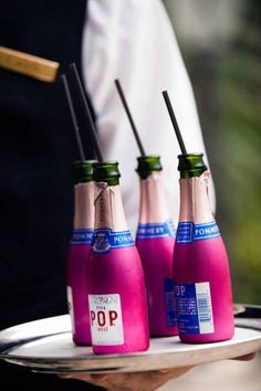 Your friends have: A traditional champagne toast.    We prefer: miniature bottles of bubbly (with straws!) for a fun, festive alternative.